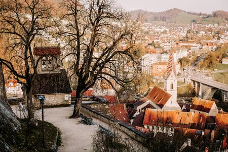 Sunset over the old town of Baden city in Switzerland, image taken from castle hill