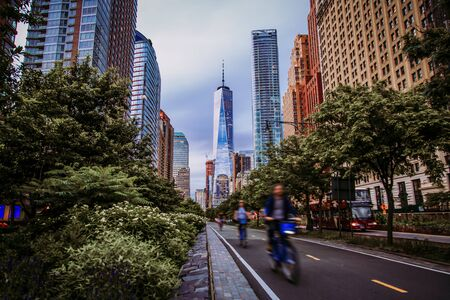 Hudson River Greenway and cyclists with One WTC view in New York City, USA