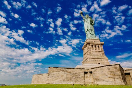 Statue of Liberty on blue sky background, New York City, USA