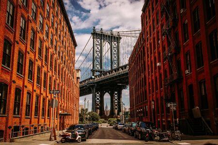 Manhattan bridge seen from a Washington Street in Brooklyn street in perspective, New York City, USA 写真素材 - 130067235