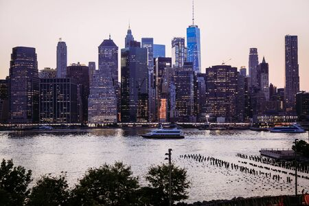 East River at dusk with Manhattan Panorama, New York City, USA 写真素材 - 130067195