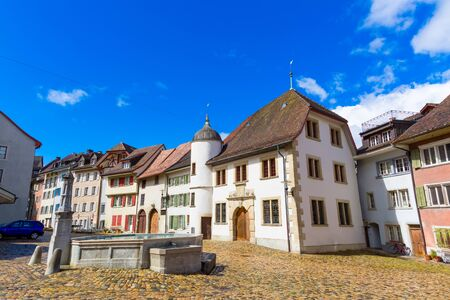 Old town buildings and fountain in Brugg town, Canton Aargau, Switzerland
