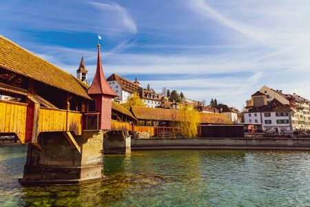 View to the old town buildings and wooden bridge over Reuss river in Lucerne, Switzerland Stockfoto