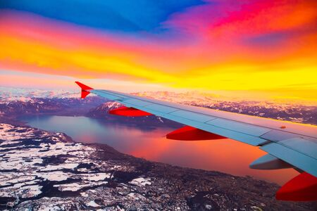 Amazing view from the airplane window during the sunset over Alps in Switzerland