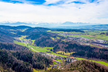 Panorama of alps and towns Wettswil, Stallikon and Bonstetten from odservation tower on Uetliberg mountain in Switzerland