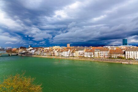 Basel architecture along Rhine River and storm clouds in Basel, Switzerland. Stockfoto
