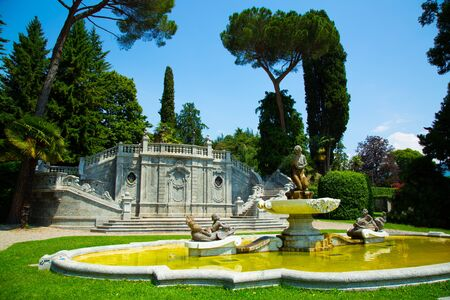 Ornamental fountain in city park over the Lake Como in Tremezzo town, Italy