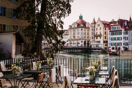Old town street and restarurant tables in Lucerne city, Switzerland Stockfoto
