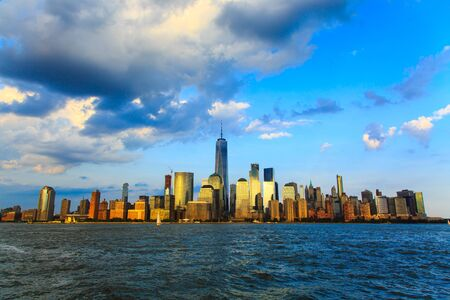 Lower Manhattan panorama and Hudson River seen from Yersey City during sunset, New York City