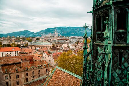 Geneva, Switzerland: city panorama seen from gothic St. Peters Cathedral tower Banco de Imagens