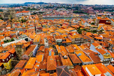 Aerial view of old historical buildings of Porto city and Vila Nova de Gaia with Douro River, Portugal