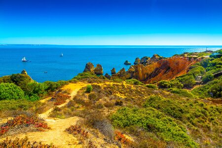 Beautiful sandy ciffs along Algarve ocean coast neer Lagos city, Portugal Banco de Imagens