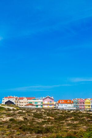 Costa Nova, Portugal: colorful striped beach houses called Palheiros next to Atlantic coast near Aveiro. Banco de Imagens