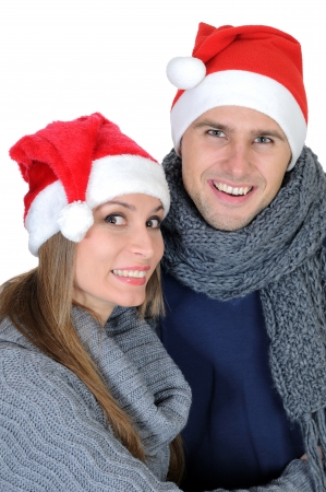 Smiling couple in Santa Claus Hat photo