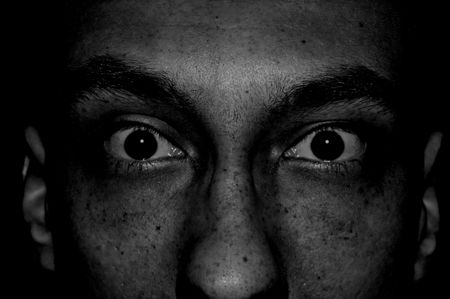 aghast: Eyes of full fears Stock Photo
