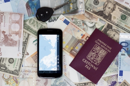 Czech passport car key and mobile phone on banknotes photo