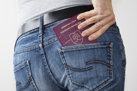 Woman taking passport out of her jeans back pocket Stock Photo - 13816737