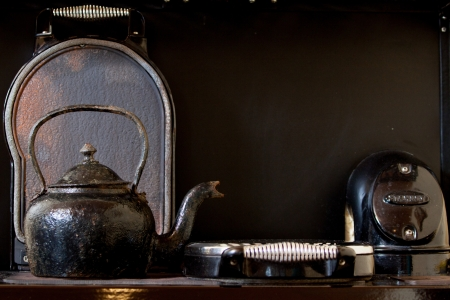 Old kettle on the stove photo