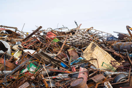 pile of large amounts of metal and waste in the junkyard for recycling
