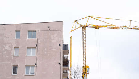 crane at the construction site next to the apartment
