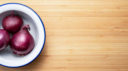 red onion on a white plate