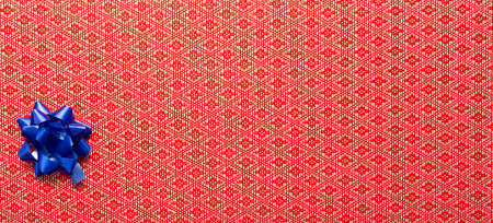 navy blue gift ribbon on red background