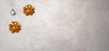 Christmas decoration golden bows on natural vintage background