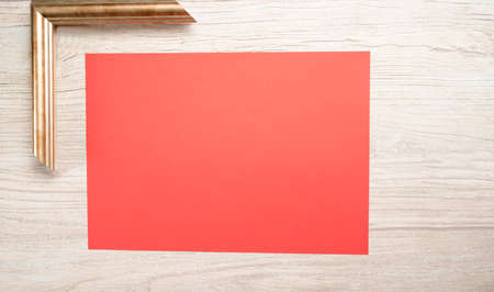 red paper for text with gold frame and wooden background 免版税图像