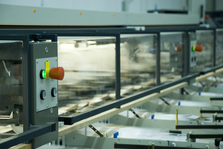 A view on a folding line, sharpness on the control panel. photo
