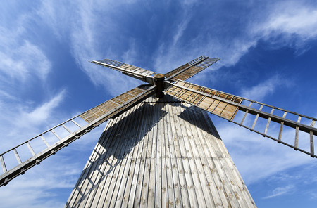 wideview: Old wooden windmill set against the sky. Stock Photo