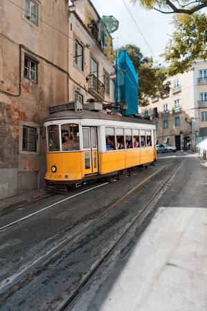 atraction: An old traditional tram on street of Lisbon, Portugal. Lisbons number 28 tram is one of the most known lines in the city.