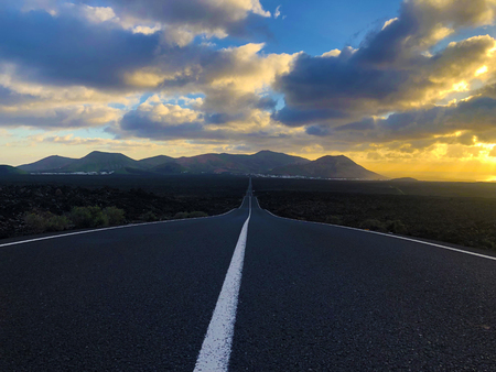 Endless road at sunset in the countryside of Lanzarote, the Canary Islands