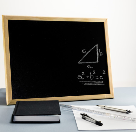 A whiteboard for teaching mathematics in school with the pythagorean theorem in graphical and mathematical formula form. Stock Photo
