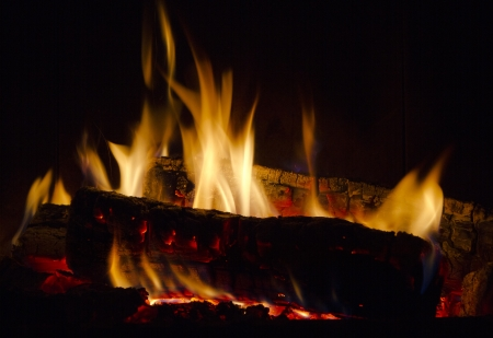 flames dance in fireplace Stock Photo