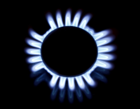 Blue flames of gas stove in the dark. Stock Photo