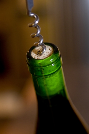 Uncorking a bottle of fine archival wine. Stock Photo