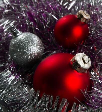 Red and silver Christmas baubles border on fur