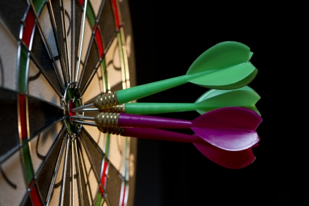 All darts hitting the target Stock Photo