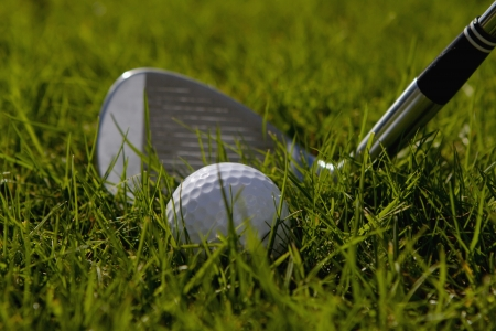 play golf: A lob wedge is ready to hit a golf ball
