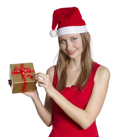 Beatiful young woman with Christmas hat unpacking gift box