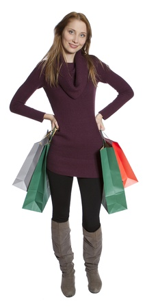 Beatiful young woman holding several shopping bags