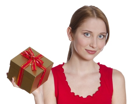 Beautiful young woman is holding a gift photo
