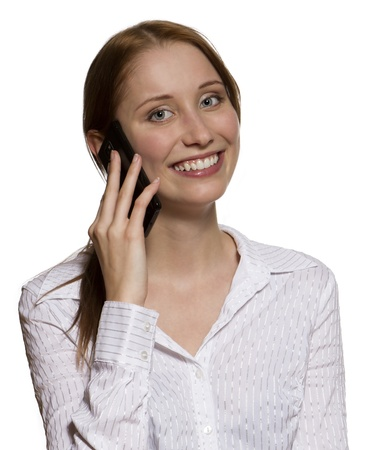 Attractive young business woman talking on her mobile phone in white shirt blouse, isolated