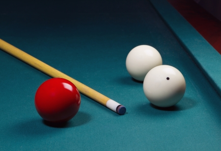 White and red carom balls with billiard cue on pocketless table Stock Photo