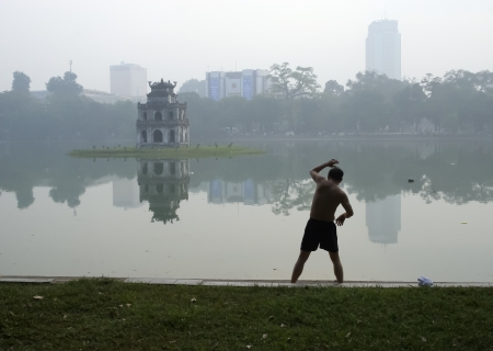 Early morning at Hoan Kiem, the little lake in the old part of Hanoi, Vietnam