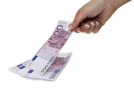 Female hand takes 500 euros from the pile, isolated on white Stock Photo