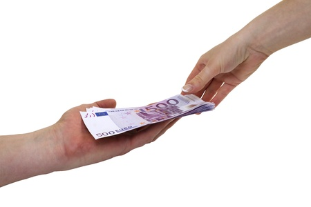 Hand handing over 500 euro banknotes to another hand, isolated on white with clipping path