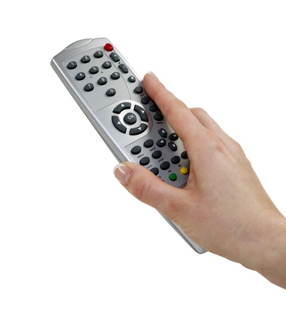 La main de femme avec une télécommande du décodeur avec chemin de détourage, isolé sur blanc