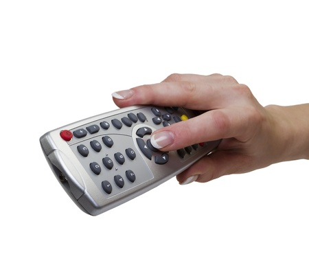 Womans hand with a remote control from the set-top box, isolated on white Stock Photo