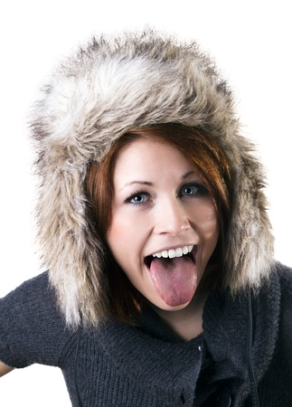 female tongue: Crazy young woman with fur cap